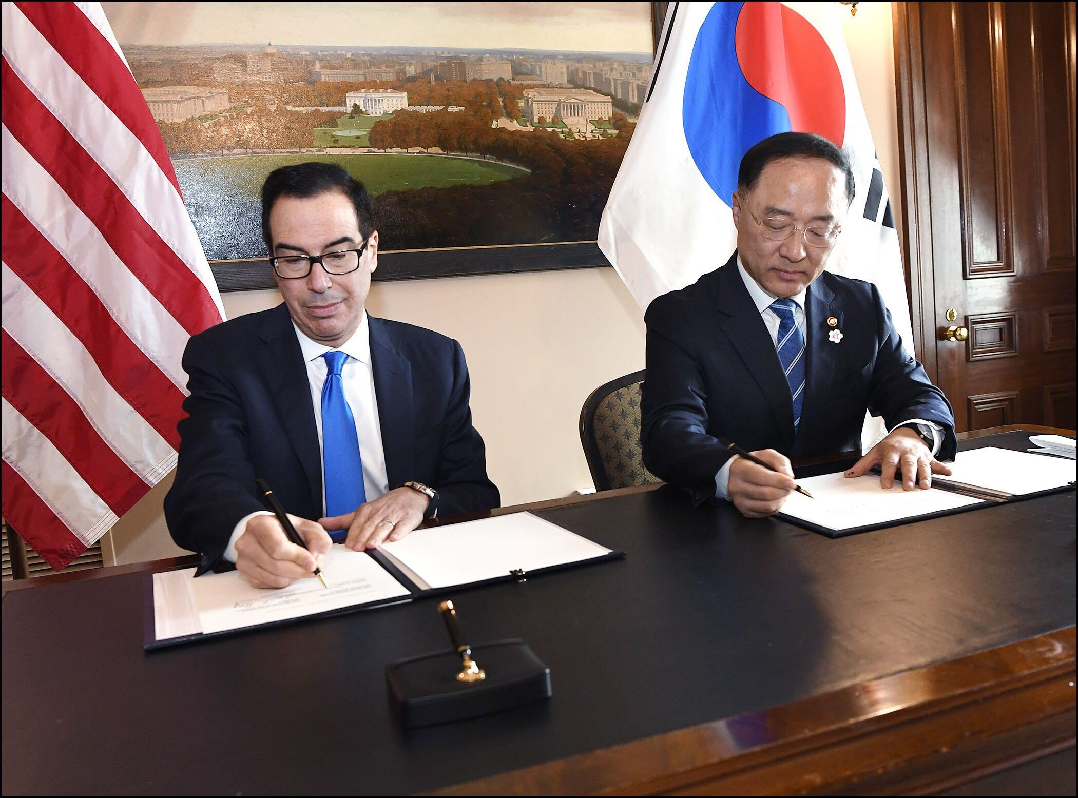 U.S. Secretary of the Treasury Steven T. Mnuchin and Korean Deputy Prime Minister and Finance Minister Hong Nam-ki sign a Memorandum of Understanding to Strengthen Infrastructure Finance and Market Building Cooperation. Photo credit: U.S. Department of the Treasury, October 17, 2019
